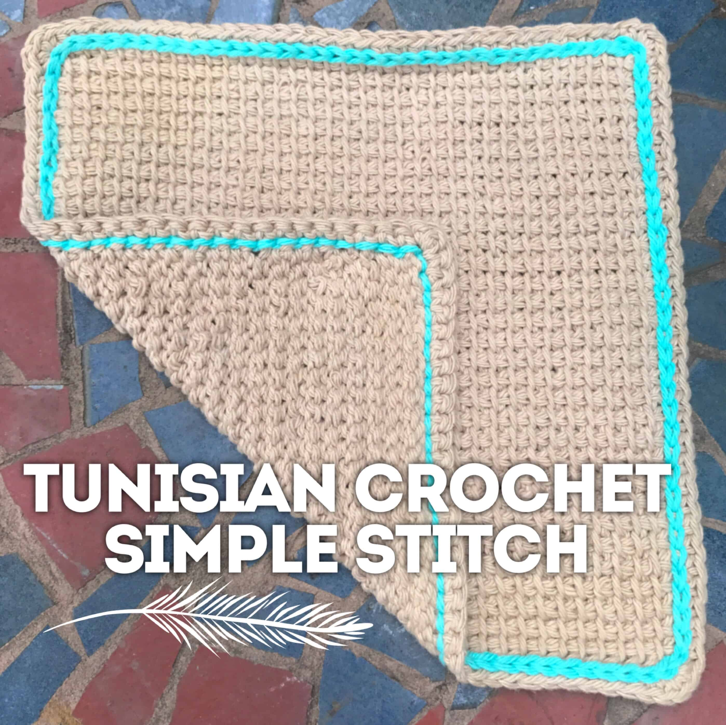 Tunisian crochet simple stitch washcloth in tan with aqua colored simple stitch border