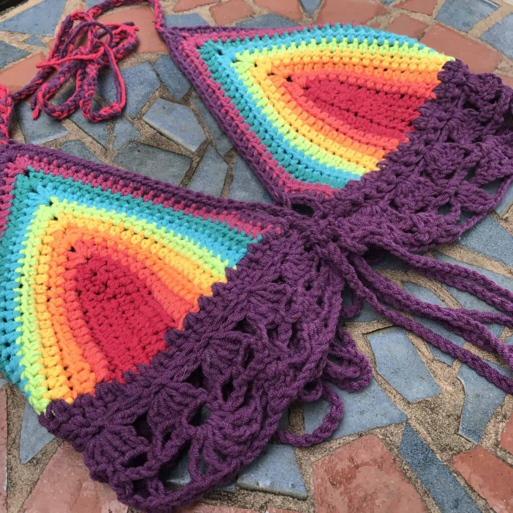 rainbow crochet bikini on table