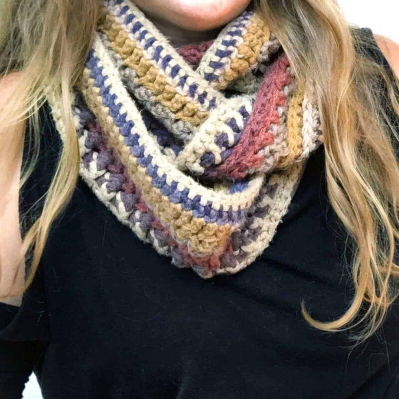 Close up of Tasha wearing the Mandala Infinity scarf